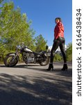 A Woman In A Red Leather Biker...