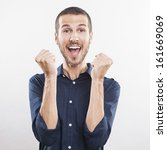 portrait of a winner young man...   Shutterstock . vector #161669069