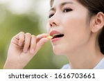 close up of asia young woman... | Shutterstock . vector #1616703661