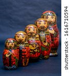 Small photo of Traditional Russian matryoshka dolls lined up against gray background, doll within a doll, object within an object, metaphor for shell companies, Russian nesting doll 6