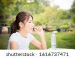 close up of woman putting pill... | Shutterstock . vector #1616737471