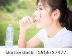 close up of woman putting pill... | Shutterstock . vector #1616737477