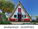 front of a traditional cottage... | Shutterstock . vector #161695361