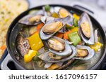 chinese mussel dish on a pan | Shutterstock . vector #1617096157