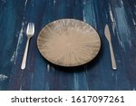 round plate with utensils on... | Shutterstock . vector #1617097261