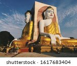 Small photo of The Kyaik Pun Pagoda consists of four giant statues of Buddha, surrounded by Planetary posts, small shrines and image houses, Bago, Myanmar