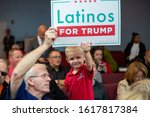 Small photo of Kissimmee, Florida/USA - January 16, 2020: Latinos for Trump Event with Vice President Mike Pence and Second Lady Karen Pence at Nacion de Fe. Kids support Trump and Pence.