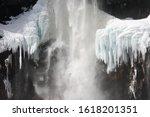 Water Falling Over Frozen Rock...