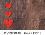 Three Red Glitter Hearts On A...