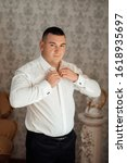 morning groom in the room.... | Shutterstock . vector #1618935697