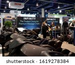 Small photo of LAS VEGAS, NEVADA - January 8, 2020: People comfortably relaxing in the welness for life Infinity massage chairs at the annual Consumer Electronics Show