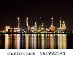 oil and gas refinery at twilight | Shutterstock . vector #161932541