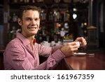 man with a cup of coffee at the ... | Shutterstock . vector #161967359