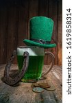 leprechaun hat stands on a... | Shutterstock . vector #1619858314
