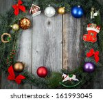 Christmas wreath with colorful ornaments and decorations - stock photo