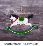 Christmas decorative ornament - Horse ornament on wooden background - stock photo