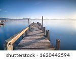 Wooden Pier Or Jetty And Lake...