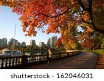 Stock photo autumn run stanley park seawall vancouver an early morning jogger on the stanley park seawall in 162046031
