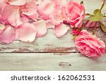 Stock photo romantic floral frame background valentines day background pink roses on wooden background 162062531