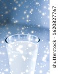 Small photo of Dairy products, healthy diet and Christmas food concept - Magic holiday drink, pouring organic lactose free milk into glass on marble table