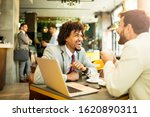 Small photo of It's lucky to do the job you love. Two businessman siting in the cafe and they talk business