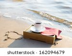 cup of coffee at the beach at... | Shutterstock . vector #162094679