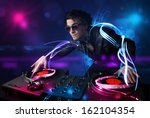 young disc jockey playing music ... | Shutterstock . vector #162104354