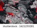 Small photo of black and white with red contrasting background of oil paints
