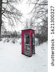 Red Telephone Box In Snowy...