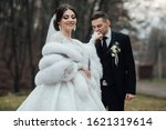 bride and groom posing. the... | Shutterstock . vector #1621319614