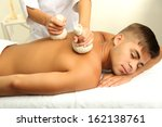 young man having back massage... | Shutterstock . vector #162138761