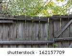 Wooden Fence In Nature As The...