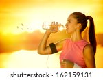 sporty woman drinking water... | Shutterstock . vector #162159131