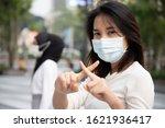 Sick woman wearing mask ...