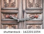 A Double Wooden Door Chained...