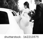 young bride gets into limo....