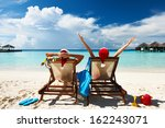 couple on a tropical beach at...   Shutterstock . vector #162243071