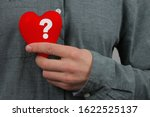 Guy Holds A Red Heart Model...