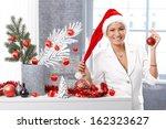 Happy Woman Smiling In Santa...