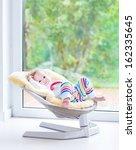Cute Little Girl Relaxing In A...