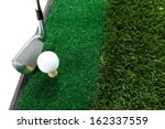 golf club and ball in grass | Shutterstock . vector #162337559