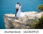 wedding couple stands on a... | Shutterstock . vector #162365915