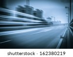 highway heading to the city in... | Shutterstock . vector #162380219