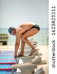 young muscular swimmer in low... | Shutterstock . vector #1623825211