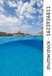 Small photo of Underwater split shot photos of the hotel resort pool.