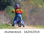 small kid with his bike on dirt ... | Shutterstock . vector #162412514