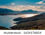 The lake of Polyfytos and the bridge of Servia at sunset.Kozani Greece