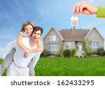 happy family near new home.... | Shutterstock . vector #162433295