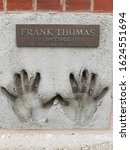 Small photo of Chicago, IL September 19, 2019, Frank Thomas professional baseball player hand prints in cement at the Chicago Sports Authority Wall of Fame 620 North LaSalle Drive