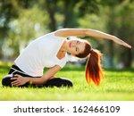 pretty woman doing yoga... | Shutterstock . vector #162466109